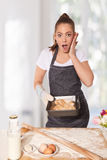 Baking woman surprised by perfect bread rolls Royalty Free Stock Photography