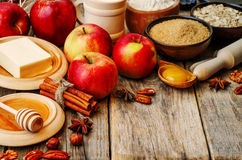 Baking wood background with apples, nuts, honey, flour and butte Royalty Free Stock Photography
