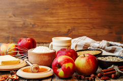 Baking wood background with apples, nuts, honey, flour and butte Stock Photos