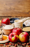 Baking wood background with apples, nuts, honey, flour and butte Stock Image