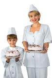 Bakkers met bevroren cakes Stock Foto