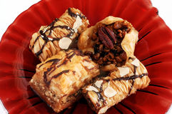 Baklava Assortment. Baklavas, red glass plate Royalty Free Stock Photo