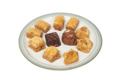 Baklava assortment on a plate. Isolated against white stock photos