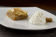 Baklava close up served with greek yogurt Stock Images