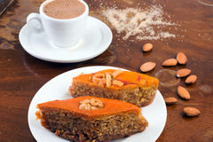 Baklava, cup of black coffee and almonds on table in café or ol Royalty Free Stock Images