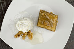 Baklava  dessert with yogurt and walnuts Royalty Free Stock Photos