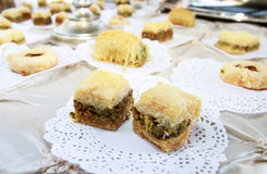 Baklava. Display of various cookies or desserts, primarily baklava which is of a Greek or Mediterranean origin.  It is a rich, sweet pastry made of layers of Stock Photography
