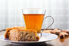 Baklava, glass of tea and nuts on cafe table or old coffee table Royalty Free Stock Photography