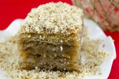 Baklava with grated walnuts on a plate Stock Photography