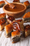 Baklava Honey with poppy seeds and nuts close-up. vertical Royalty Free Stock Photography