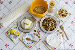 Baklava. Ingredients for homemade baklava on table with vintage tableclotch Stock Image