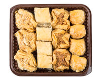 Baklava miscellaneous form in plastic box isolated on white back. Ground. Top view Royalty Free Stock Photography