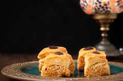 Baklava. Pieces served on a rustic plate.  is a popular sweet in the Middle East made from many layers of filo pastry and filled with nuts soaked in syrup Royalty Free Stock Image