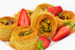 Baklava with pistachio nuts and strawberry Royalty Free Stock Photo