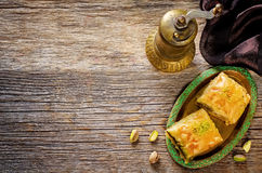 Baklava with pistachio. turkish traditional delight. On a dark wood background. toning. selective focus on top baklava royalty free stock photography