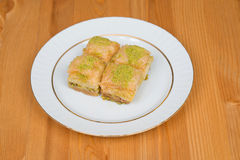 Baklava with pistachio. turkish traditional delight on a wood background. Stock Photography