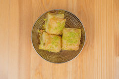 Baklava with pistachio. turkish traditional delight on a wood background. Royalty Free Stock Photos
