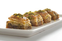 Baklava with pistachio on a white plate. And background Royalty Free Stock Photos