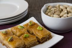 Baklava with Pistachios and Plates Stock Image