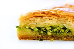 Baklava with pistachios, walnuts and honey on white background. Jewish, turkish, arabic traditional national dessert Stock Photos