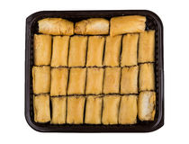 Baklava in plastic box isolated on white. Background, top view Royalty Free Stock Images