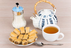 Baklava in saucer, sugar bowl and tea in cup Stock Images