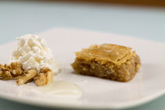 Baklava served with greek yogurt and honey Royalty Free Stock Images