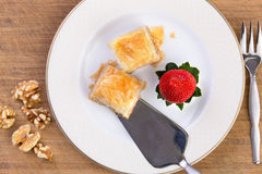 Baklava Served with Spatula on Bamboo Cutting Board Royalty Free Stock Photos