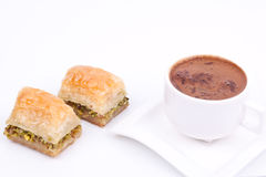 Baklava and turkish coffee. On a white background Royalty Free Stock Photo