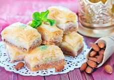 Baklava, Turkish dessert. On metal plate and on a table Stock Photography