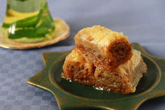 Baklava- turkish dessert. Baklava, turkish traditional dessert with fresh mint and mint tea stock image