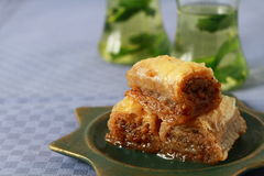 Baklava- turkish dessert. Baklava, turkish traditional dessert with fresh mint and mint tea royalty free stock image