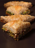 Baklava. Turkish traditional dessert made of layers of filo filled with pistachio and nuts, all held together by honey syrup Stock Image