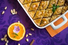 Baklava with walnut and almonds. Sweet honey Baklava with walnut and almonds on purple background Royalty Free Stock Photo