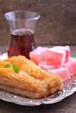 Baklava with walnuts and Turkish delight with tea Royalty Free Stock Photography