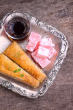 Baklava with walnuts and Turkish delight with tea Royalty Free Stock Images