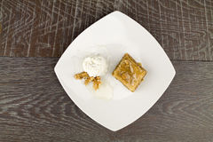 Baklava and white yogurt on wooden table Stock Images