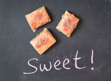 Baklawa. Sweet pastry sweets on a black surface Stock Photography