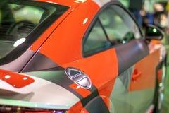 Baklykta och parkeringsljus en tävlings- röd bil för sportar, på den autobody autoexhibitionen Royaltyfri Fotografi