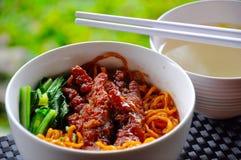 Bakmi served with kaki ayam Royalty Free Stock Images