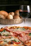 Bakon and ham pizza. Delicious pizza with bacon, cheese and ham served with red wine stock photos