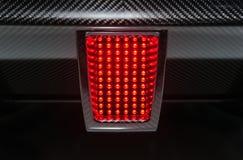 Bakre ljus för sportbil Arkivbilder