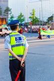 Bakre rikta trafik för den koreanska polispolisen Arkivbild