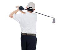 Bakre sikt av den svängande golfklubben för asiatisk kinesisk man Fotografering för Bildbyråer