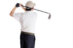 Bakre sikt av den svängande golfklubben för asiatisk kinesisk man Arkivfoton