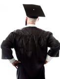 Bakre sikt av ett högt mankandidatanseende med akimbo armar Royaltyfri Fotografi