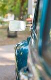 Bakre spegel av en gammal bil Fotografering för Bildbyråer