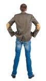 Baksida beskådar av affärsmanar klår upp in passar. royaltyfri fotografi