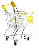 Baksida beskådar shoppingvagnen på vitbakgrund Arkivbild