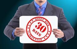 Baksida för 30 dagar garantipengar Arkivbild
